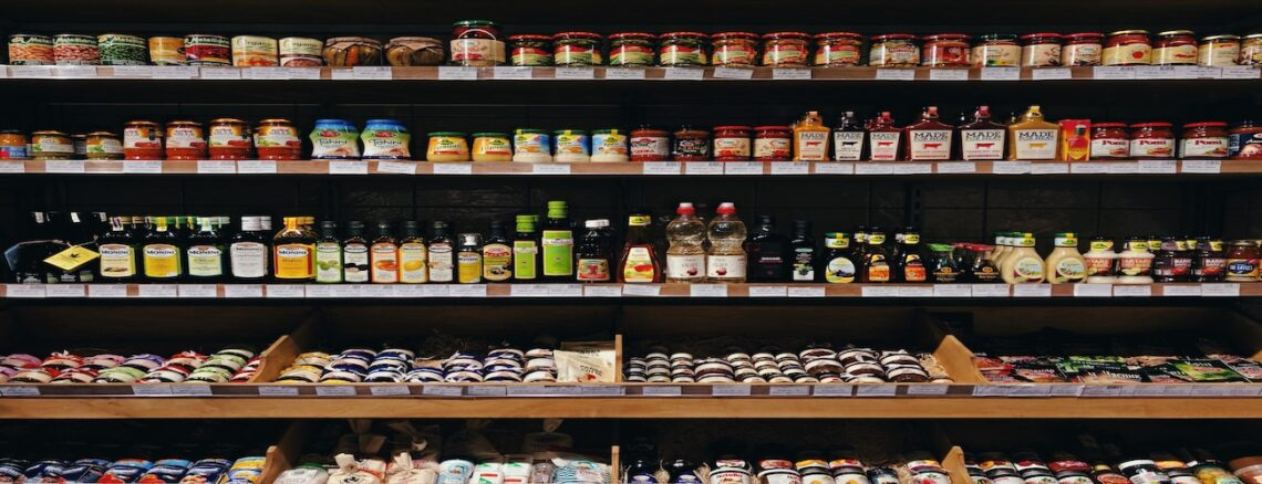 Shelves filled with bottles and cans of food