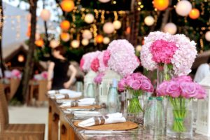 Pink hydrangeas and roses on a dining table