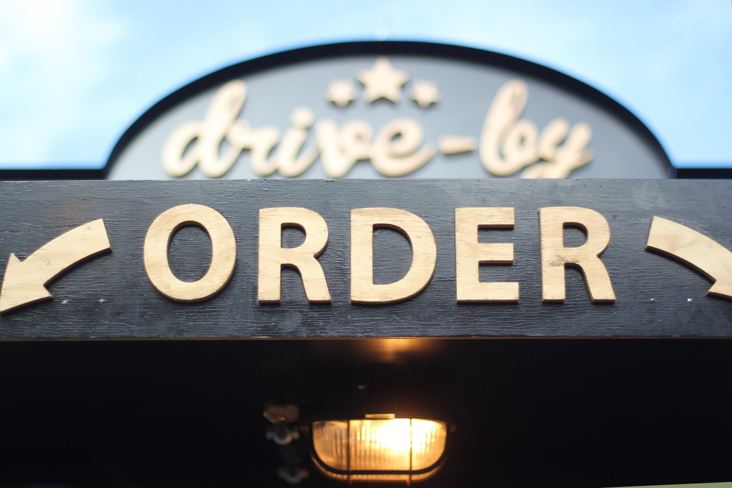 Restaurant drive by order sign