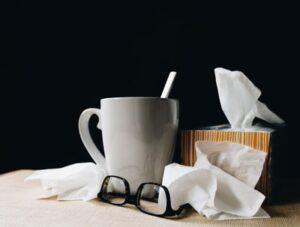 A white tea mug and wadded up kleenex