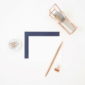 White desktop with blue & white envelopes