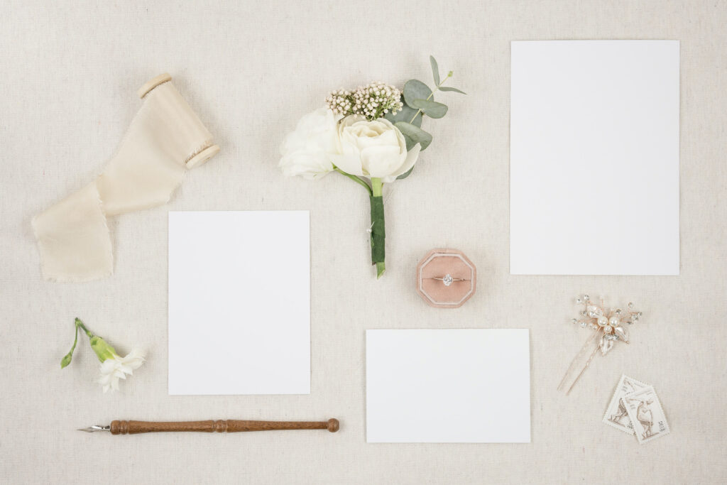flatlay of paper and pens to simulate wedding venue brochures