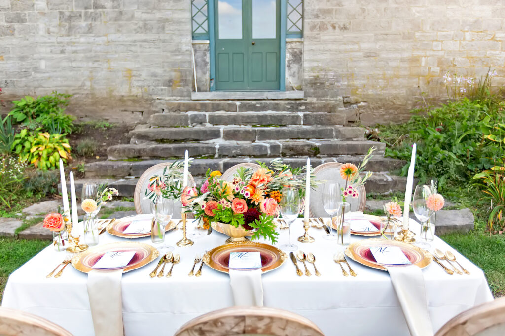 Table spread with white tablecloth and flatwear for a wedding party
