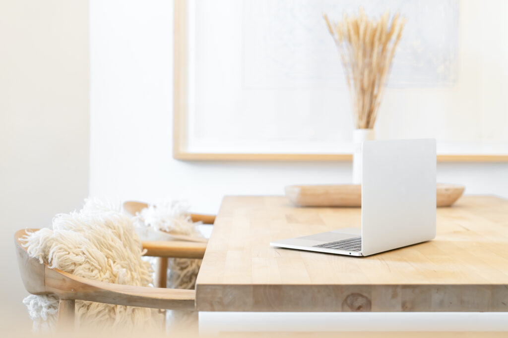 Laptop on a wooden table