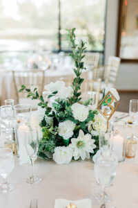 Green and white centerpiece on a table at a wedding