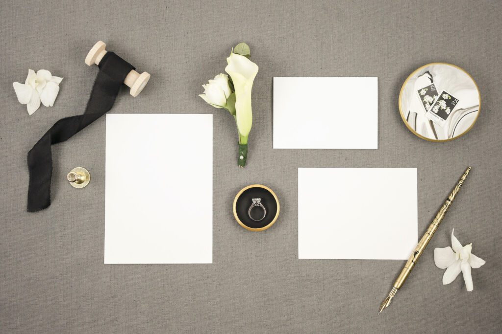 Cardstock on a grey background with gold pen and white flowers