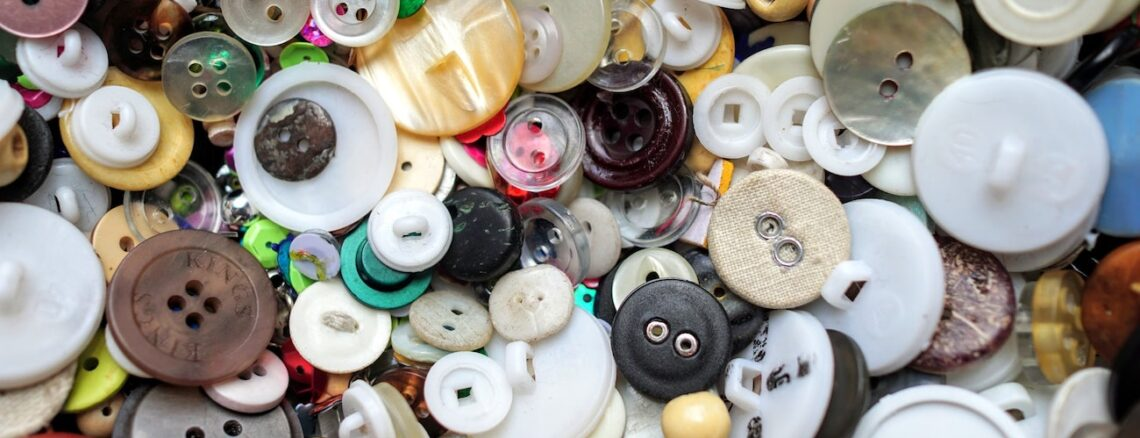 Assorted clothing buttons of different shapes and colors